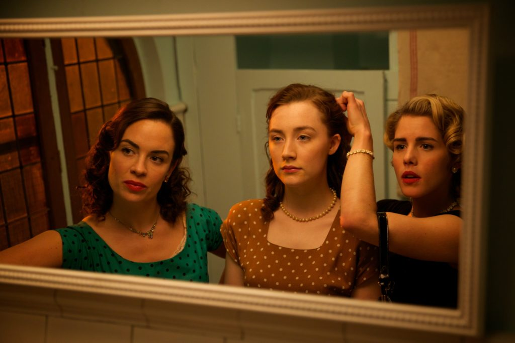 """Eve Macklin as """"Diana,"""" Saoirse Ronan as """"Eilis"""" and Emily Bett Rickards as """"Patty"""" in BROOKLYN. Photo by Kerry Brown. © 2015 Twentieth Century Fox Film Corporation All Rights Reserved"""